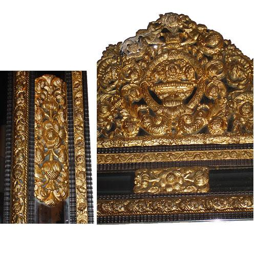 A Fine Flemish Brass Repoussé and Ebonized Carved Wood Mirror No. 2534