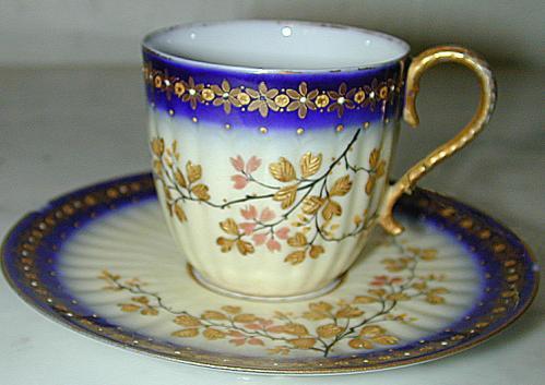 A Miniature Porcelain Cup & Saucer No. 1201
