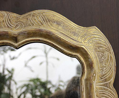 A Mid-20th Century Shaped Parcel-Gilt and White Polychrome Mirror No. 4176