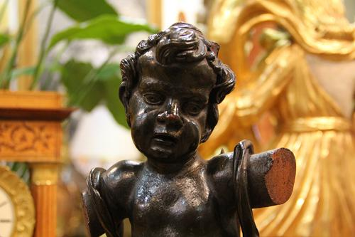An 18th Century Italian Ebonized Walnut Statue of a Putti No. 4440