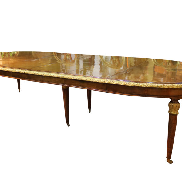 A Fine Late 18th Century Italian Walnut and Parcel Gilt Dining Table