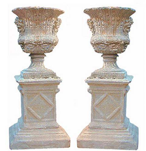 An Imposing Pair of Late 19th Century Cast Stone Borghese Urns Embellished with Bacchanalian Masks No. 2562