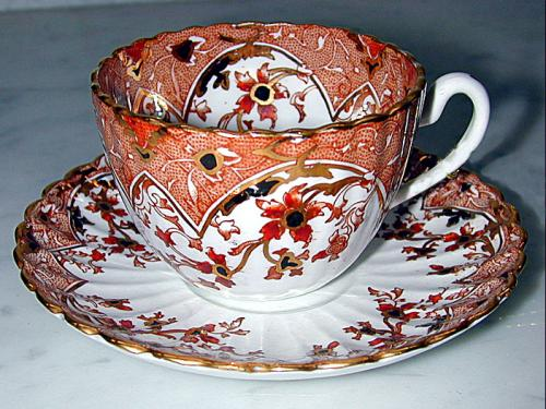 A Miniature Hand-Painted Porcelain Cup & Saucer Set  No. 1197