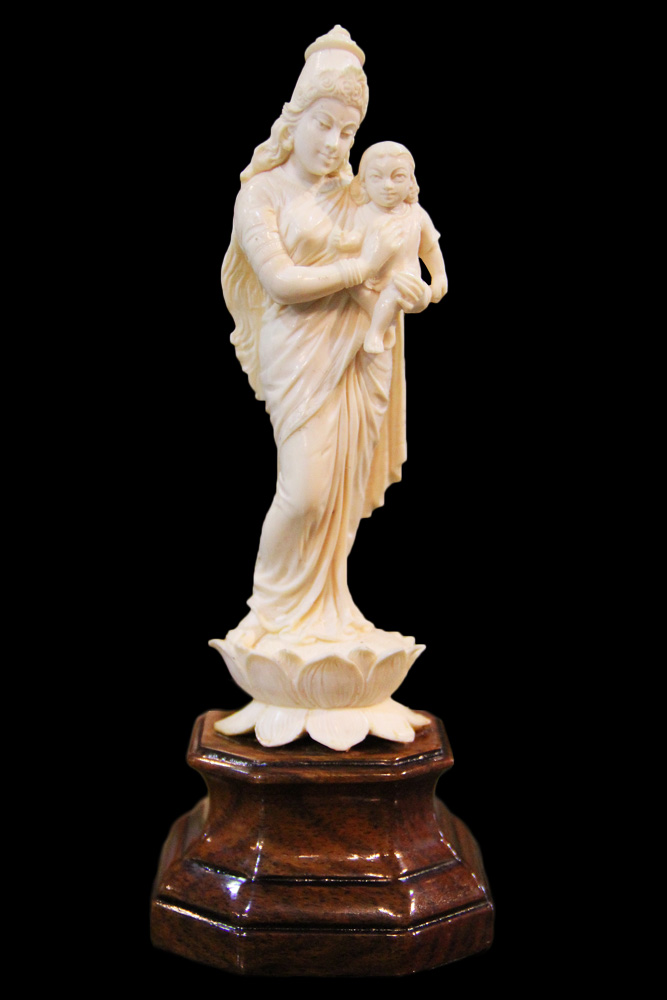 A 19th Century Chinese Bone Statue of Goddess Kwan Yin and an Infant, No. 4590